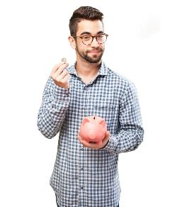 Man holding piggy bank and coin